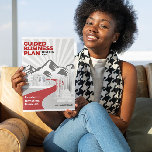Woman holding GUIDED Business Plan book